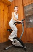 Woman Workout On Stationary Bicycle