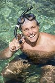 Happy man snorkelling