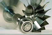 foto of mechanical engineering  - precision engineered turbines with a gray background - JPG