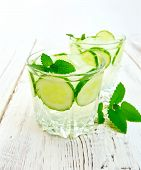 Постер, плакат: Lemonade with cucumber and mint on board