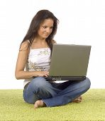 Young Woman With Laptop On The Green Carpet