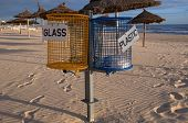 Separate Waste Baskets On The Beach
