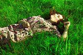 A Beautiful Girl Lies In A Green Grass