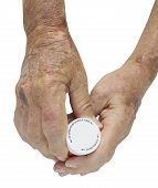 Picture of male hand arthritis holding pills - with clipping path.