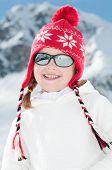 Little girl in winter resort