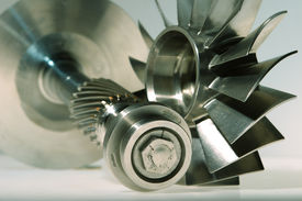 foto of mechanical engineer  - precision engineered turbines with a gray background - JPG