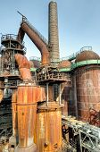 picture of blast-furnace  - An old decaying steelworks rustingand rotting with blast furnace - JPG