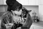 Woman Kisses A Dog