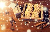 christmas, baking, holidays and food concept - close up of oat cookies in wooden box, gift with blan poster