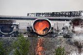 picture of slag  - drain slag carts at steel making plant - JPG