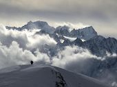 Skiers On Top Of Mountain In Swiss Alps, Verbier