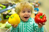 Happy Vegetables Child. Cute Kid In Supermarket Holds Bulgarian Sweet Pepper For Salad. Healthy Food poster