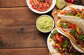Three Mexican Tacos With Marbled Beef, Black Angus And Vegetables On Old Rustic Table. Mexican Dish poster