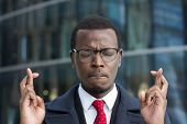 Horizontal Headshot Of Young African Businessman Pictured In Urban Environment Feeling Worried And U poster
