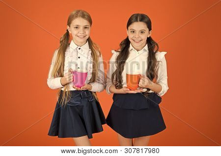poster of A Very Good Morning To You. Little Children Drinking Morning Tea Or Coffee. Cute Schoolgirls Holding