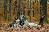 Wild In Soul. Siberian Husky Favorite Pet. Animal Husbandry. Girl Pretty Stylish Woman Walking With  poster