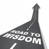 The words Road to Wisdom on a road leading upward to the future, increasing your intelligence and en