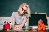 Portrait Of Confident Young Caucasian Female Teacher. Student Preparing For Test Or Exam. Exam In Co poster