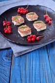 Canape With Foie Gras On The Black Plate. Red Currant Berries Around poster