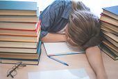 Stressed College Student Tired Of Hard Learning With Books In Exams Tests Preparation, Overwhelmed H poster