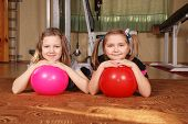 Two Children Posing In A Gym.