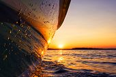 Side View Speeding Fishing Motor Boat With Drops Of Water. Blue Ocean Sea Water Wave Reflections At poster