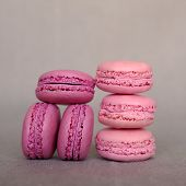 Stack Of Delicious French Raspberry And Blueberry Flavour Macarons On Grey Background. French Pastry poster