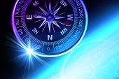 Compass composition for traveler, conceptual color photo, suitable also as a background image