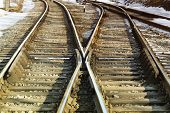stock photo of girder  - Rail crossing with  snow along the edges - JPG