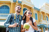 Young Interracial Couple Tourist Backpackers Enjoying Traveling In Bangkok City Thailand On Summer H poster