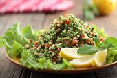 Tabbouleh salad closeup on a rustic table