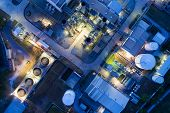 Aerial View Night Light Oil Terminal Is Industrial Facility For Storage Of Oil And Petrochemical. Oi poster