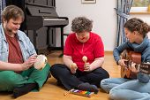 A Group With A Mentally Disabled Woman Enjoys A Music Therapy poster