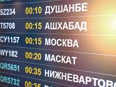 Electronic Scoreboard Flights And Airlines. Destinations Wrote In Russian Language Translate Are: Du poster