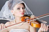 Bride playing violin in studio
