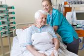 Senior patient and nurse in hospital poster