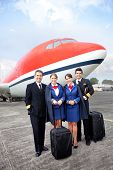foto of cabin crew  - Airplane cabin crew standing at the airport with bags - JPG