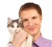picture of minion  - Smiling young man holds surprised cat isolated on white background - JPG
