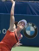 Jelena Jankovic of Serbia serves ball
