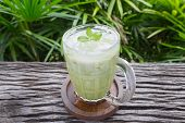 Cold Green Tea Milk Beverage Or Cold Drinks Center Frame Normal View. Green Cold Drinks And Ice On W poster