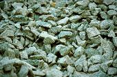 Road Gravel And Granite Gravel Texture. Crushed Gravel Background. Pile Of Stones Texture. Industria poster