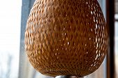 Wicker Straw Lampshade Closeup. Natural Crossed Straw Woven Lattice Texture With Backlighting. Shape poster