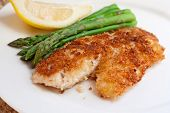 Fried Breaded Fish With Asparagus And Lemon