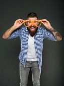 Goggles Do More Than Improve Your Vision. Bearded Man Wearing Fancy Goggles On Grey Background. Brut poster