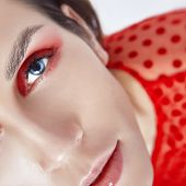 Bright Red Makeup On The Womans Face, Professional Natural Cosmetics For Skin Care. Bright Red Eye  poster