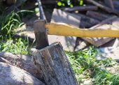 Old Rusty Ax Stuck In Old Rusty Ax Stuck In An Old Log, Chopping Wood.an Old Log, Chopping Wood. poster