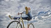 Woman Feels Free While Enjoy Cycling. Girl Rides Bicycle Sky Background. Cycling Gives You Feeling O poster