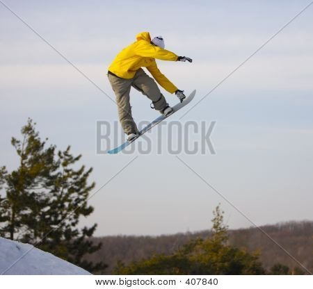 Picture or Photo of Snowboarder catching some big air