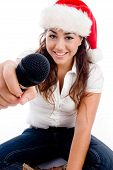 Model Wearing Christmas Hat And Showing Microphone