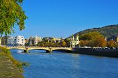 view of Maria Cristina Bridge and Urumea River in San Sebastian, Spain, in autumn